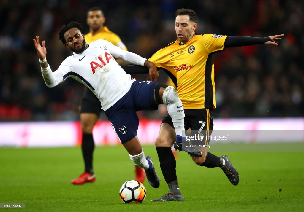 Robbie Willmott of Newport County fouls Danny Rose of Tottenham Hotspur during The Emirates FA Cup Fourth Round Replay match between Tottenham Hotspur and Newport County at Wembley Stadium on February 7, 2018 in London, England.