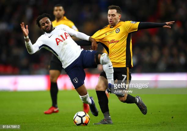 Robbie Willmott of Newport County fouls Danny Rose of Tottenham Hotspur during The Emirates FA Cup Fourth Round Replay match between Tottenham...