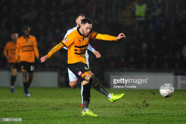 Robbie Willmott of Newport County has a shot during the FA Cup Fourth Round Replay match between Newport County and Middlesbrough at Rodney Parade on...