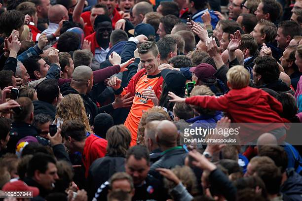 Robbin Ruiter of Utrecht is congratulated be the fans after winning the Eredivisie Europa League Play off match between FC Utrecht and FC Twente at...