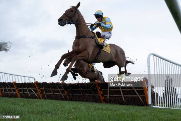 Robbin'hannon ridden by Richard Johnson jumps a fence to during the Betfair Stayers' Handicap Hurdle on November 25 2017 in Haydock England