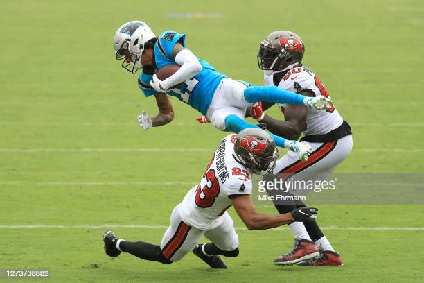 Robby Anderson of the Carolina Panthers is upended as he is tackled by Sean Murphy-Bunting and Jason Pierre-Paul of the Tampa Bay Buccaneers during...