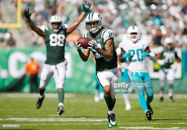 Robby Anderson of the New York Jets catches a touchdown pass against the Miami Dolphins during the first half of an NFL game at MetLife Stadium on...
