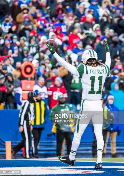 Robby Anderson of the New York Jets celebrates a touchdown reception during the fourth quarter against the Buffalo Bills at New Era Field on December...