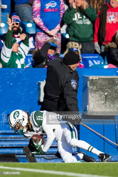 Robby Anderson of the New York Jets collides with a police officer after making a first down reception during the second quarter against the Buffalo...
