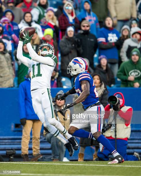 Robby Anderson of the New York Jets makes a first down reception against Tre'Davious White of the Buffalo Bills during the final minutes of the...