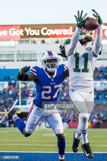 Robby Anderson of the New York Jets makes a reception out of bounds near the end zone during the fourth quarter against Tre'Davious White of the...