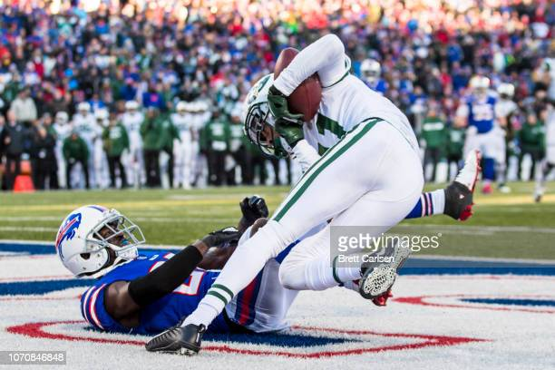 Robby Anderson of the New York Jets makes a touchdown reception against Tre'Davious White of the Buffalo Bills during the fourth quarter at New Era...