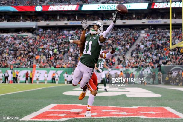 Robby Anderson of the New York Jets reaches for what would be an incomplete pass in the fourth quarter against the Kansas City Chiefs during their...