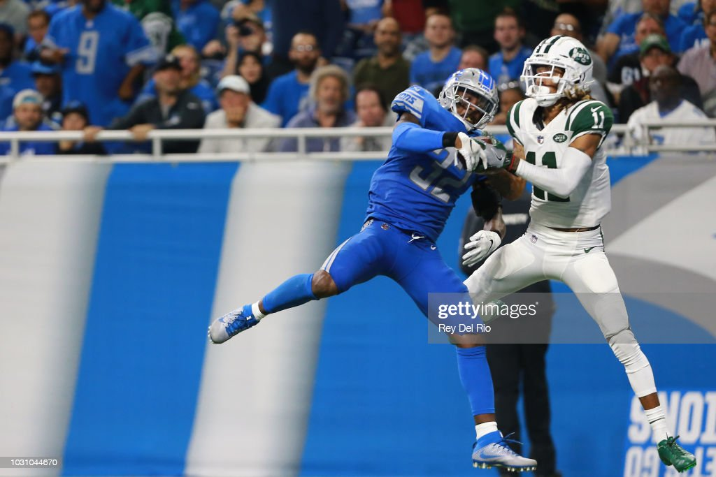 Robby Anderson #11 of the New York Jets scores a touchdown in front of Tavon Wilson #32 of the Detroit Lions in the second quarter at Ford Field on September 10, 2018 in Detroit, Michigan.