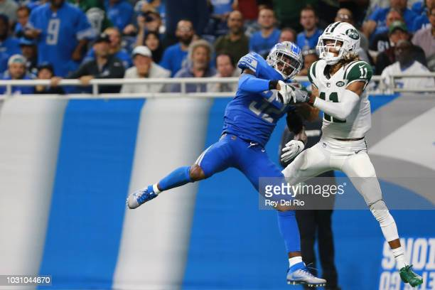 Robby Anderson of the New York Jets scores a touchdown in front of Tavon Wilson of the Detroit Lions in the second quarter at Ford Field on September...