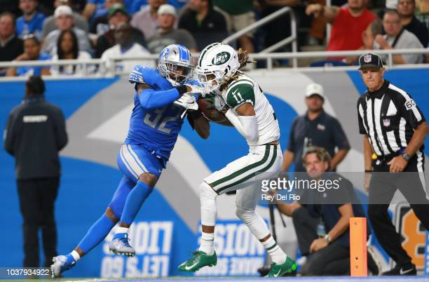 Robby Anderson of the New York Jets scores a touchdown in front of Tavon Wilson of the Detroit Lions in the second quarter at Ford Field The Jets won...