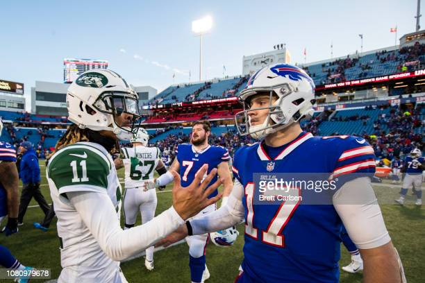 Robby Anderson of the New York Jets shakes hands with Josh Allen of the Buffalo Bills after the game at New Era Field on December 9 2018 in Orchard...