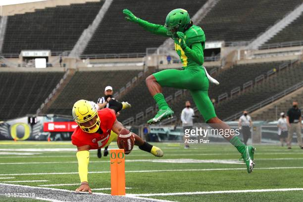 Robby Ashford of the Oregon Ducks dives to score a touchdown against Bryan Addison of the Oregon Ducks on the play of the game in the fourth quarter...