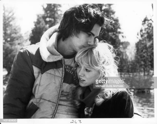 Robby Benson kisses LynnHolly Johnson's head in a scene from the film 'Ice Castles' 1978