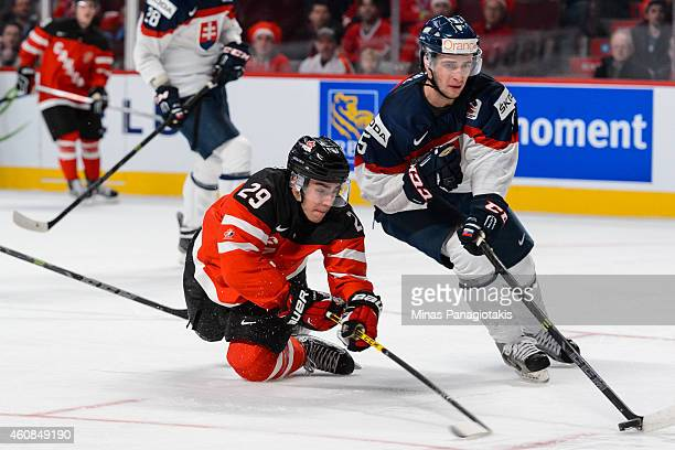 Robby Fabbri of Team Canada dives to poke the puck from Marco Hochel of Team Slovakia during the 2015 IIHF World Junior Hockey Championship game at...