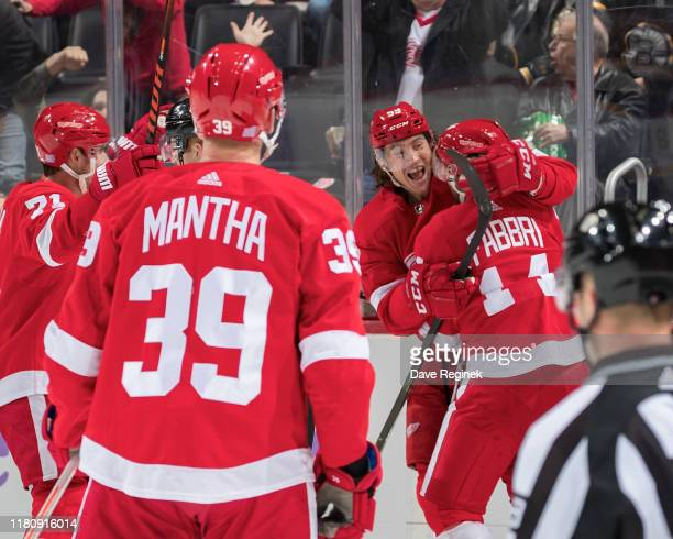 Robby Fabbri of the Detroit Red Wings celebrates his first goal as a Wing with teammates Dylan Larkin Anthony Mantha and Tyler Bertuzzi during the...