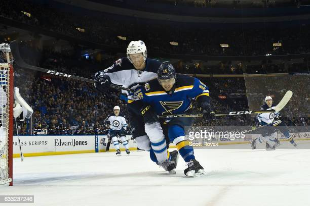 Robby Fabbri of the St Louis Blues and Jacob Trouba of the Winnipeg Jets battle for the puck on January 31 2017 at Scottrade Center in St Louis...