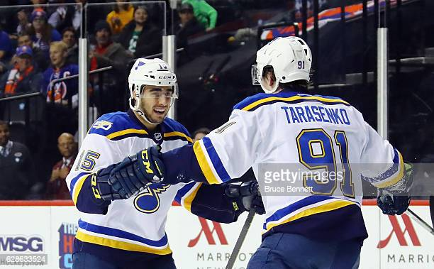 Robby Fabbri of the St Louis Blues celebrates his goal at 436 of the first period against the New York Islanders and is joined by Vladimir Tarasenko...
