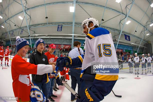 Robby Fabbri of the St Louis Blues gives a jersey to a young fan after a preseason Kraft Hockeyville game against the Detroit Red Wings at the...
