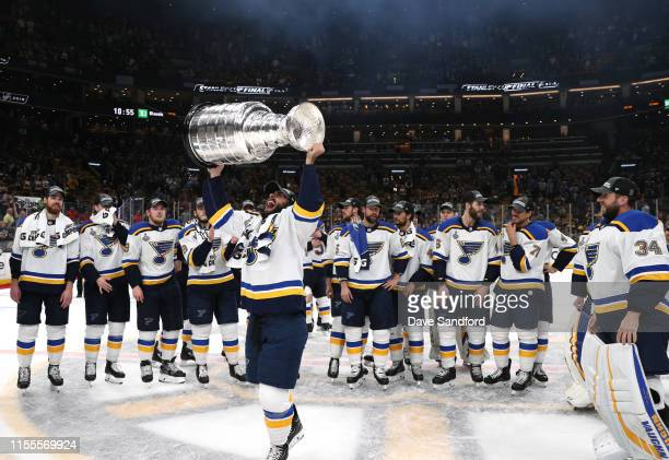 Robby Fabbri of the St Louis Blues hoists the Stanley Cup on the ice after the 2019 NHL Stanley Cup Final at TD Garden on June 12 2019 in Boston...