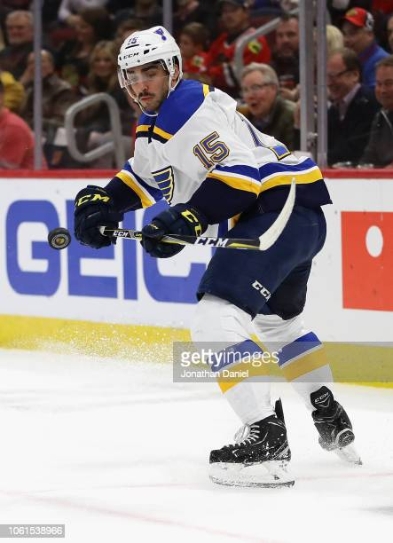 Robby Fabbri of the St Louis Blues knocks the puck down with his stick against the Chicago Blackhawks at the United Center on November 14 2018 in...