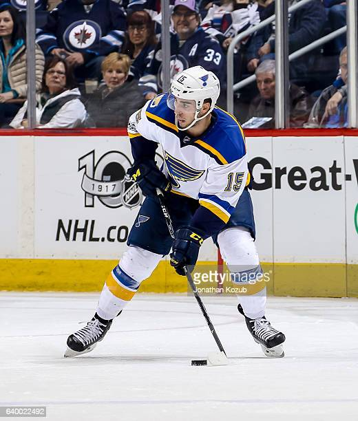 Robby Fabbri of the St Louis Blues plays the puck during third period action against the Winnipeg Jets at the MTS Centre on January 21 2017 in...