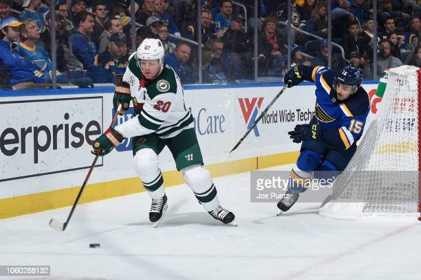 Robby Fabbri of the St Louis Blues pressures Ryan Suter of the Minnesota Wild at Enterprise Center on November 11 2018 in St Louis Missouri