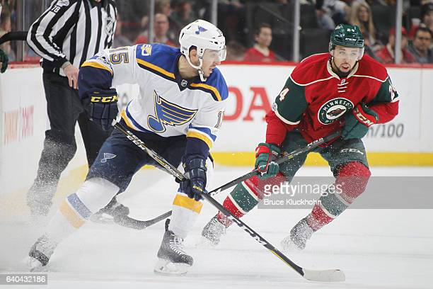 Robby Fabbri of the St Louis Blues skates with the puck while Matt Dumba of the Minnesota Wild defends during the game on January 26 2017 at the Xcel...