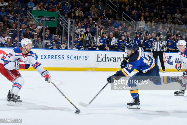 Robby Fabbri of the St Louis Blues takes a shot as Kevin Shattenkirk of the New York Rangers defends at Enterprise Center on December 31 2018 in St...