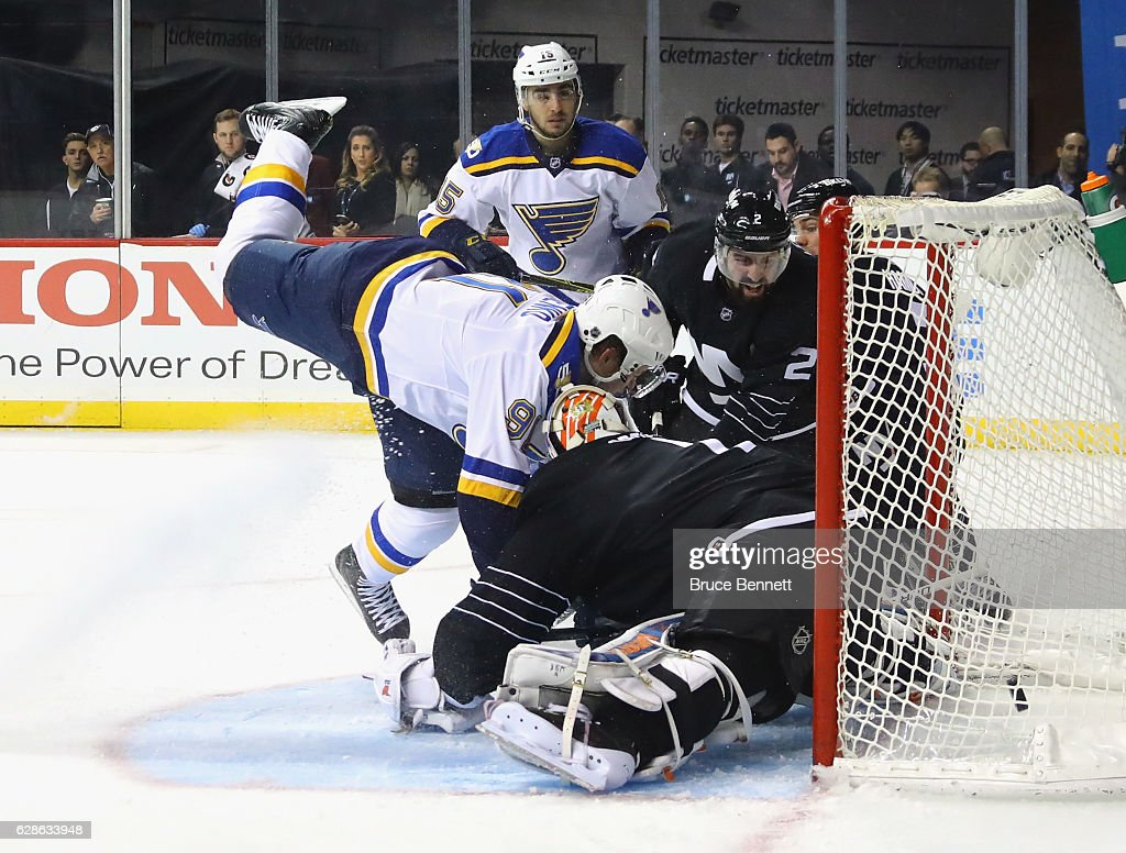 Robby Fabbri #15 of the St. Louis Blues watches his goal at 4:36 of the first period against the New York Islanders as Vladimir Tarasenko #91 crashes into Thomas Greiss #1 at the Barclays Center on December 8, 2016 in the Brooklyn borough of New York City.