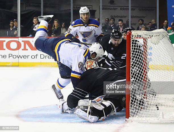 Robby Fabbri of the St. Louis Blues watches his goal at 4:36 of the first period against the New York Islanders as Vladimir Tarasenko crashes into...