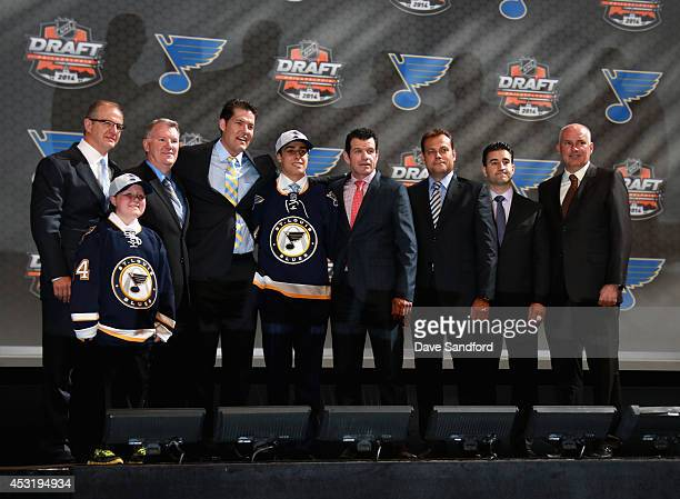 Robby Fabbri stands with team personnel after being selected 21st overall by the St Louis Blues during the 2014 NHL Entry Draft at Wells Fargo Center...