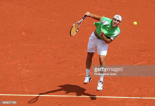 Robby Ginepri of the United States in action during the men's singles fourth round match against Novak Djokovic of Serbia on day nine of the French...