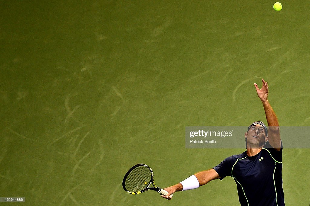 Robby Ginepri of the United States serves a shot to Tomas Berdych of Czech Republic during Day 3 of the Citi Open at the William H.G. FitzGerald Tennis Center on July 30, 2014 in Washington, DC.