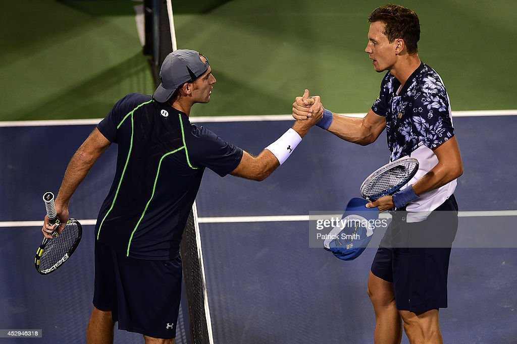 Robby Ginepri of the United States (L) shakes hands with Tomas Berdych of Czech Republic after losing during Day 3 of the Citi Open at the William H.G. FitzGerald Tennis Center on July 30, 2014 in Washington, DC.