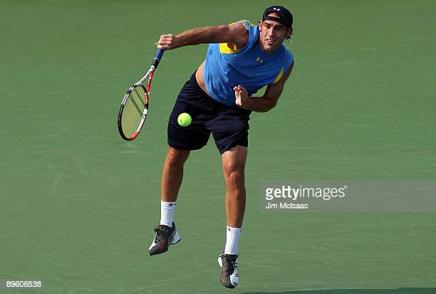 Robby Ginepri serves to Benjamin Becker of Germany during Day 2 of the Legg Mason Tennis Classic at the William H.G. FitzGerald Tennis Center August...