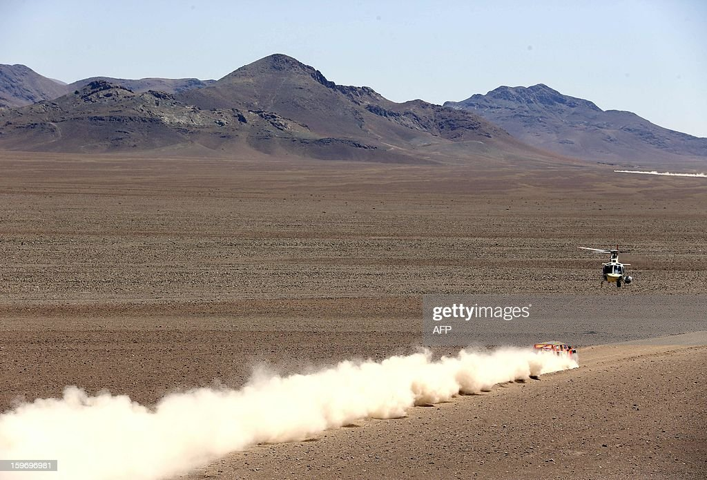 US Robby Gordon and co-driver Kellon Walch on Hummer compete during the Stage 13 of the 2013 Dakar Rally between Copiapo and La Serena, in Chile, on January 18, 2013. The rally is taking place in Peru, Argentina and Chile from January 5 to 20.