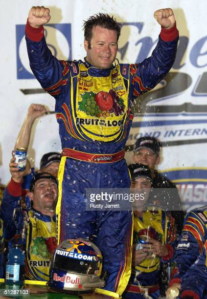 Robby Gordon driver of the Fruit of the Loom Chevrolet celebrates after winning the NASCAR Busch Series Emerson Radio 250 on September 10 2004 at...