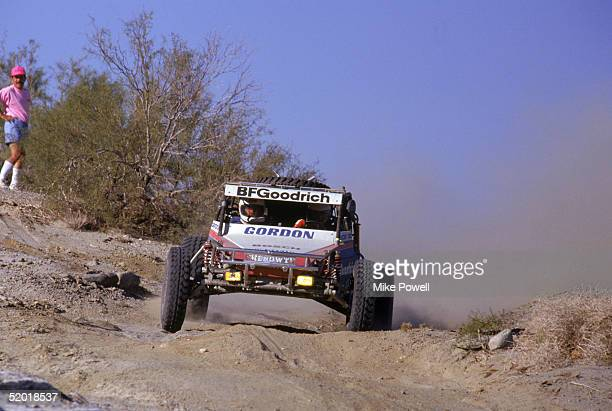 Robby Gordon races his BF Goodwrench offroad vehicle as he competes in the Baja 1000 Desert Race on November 9 1990 in Baja California Mexico