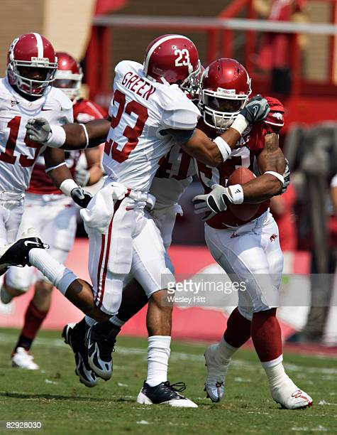 Robby Green of the Alabama Crimson Tide tackles Dennis Johnson of the Arkansas Razorbacks at Donald W Reynolds Stadium on September 20 2008 in...