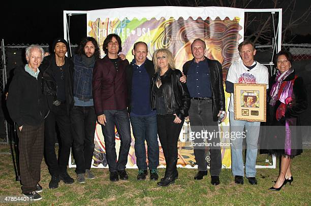 Robby Kregier Doug Pinnick Rusty Anderson Wayne Kramer Lucinda Williams Phil Alvin and Joe Corbett attend the US Postal Service unveiling of the Jimi...