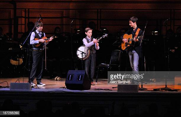 Robby Mizzone Jonny Mizzone and Tommy Mizzone of The Sleepy Man Banjo Boys perform on stage at The American Christmas Carol Benefitting The Golden...