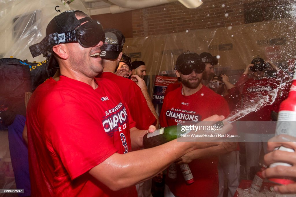 Robby Scott #63 of the Boston Red Sox celebrates in the clubhouse after clinching the American League East Division against the Houston Astros on September 30, 2017 at Fenway Park in Boston, Massachusetts.
