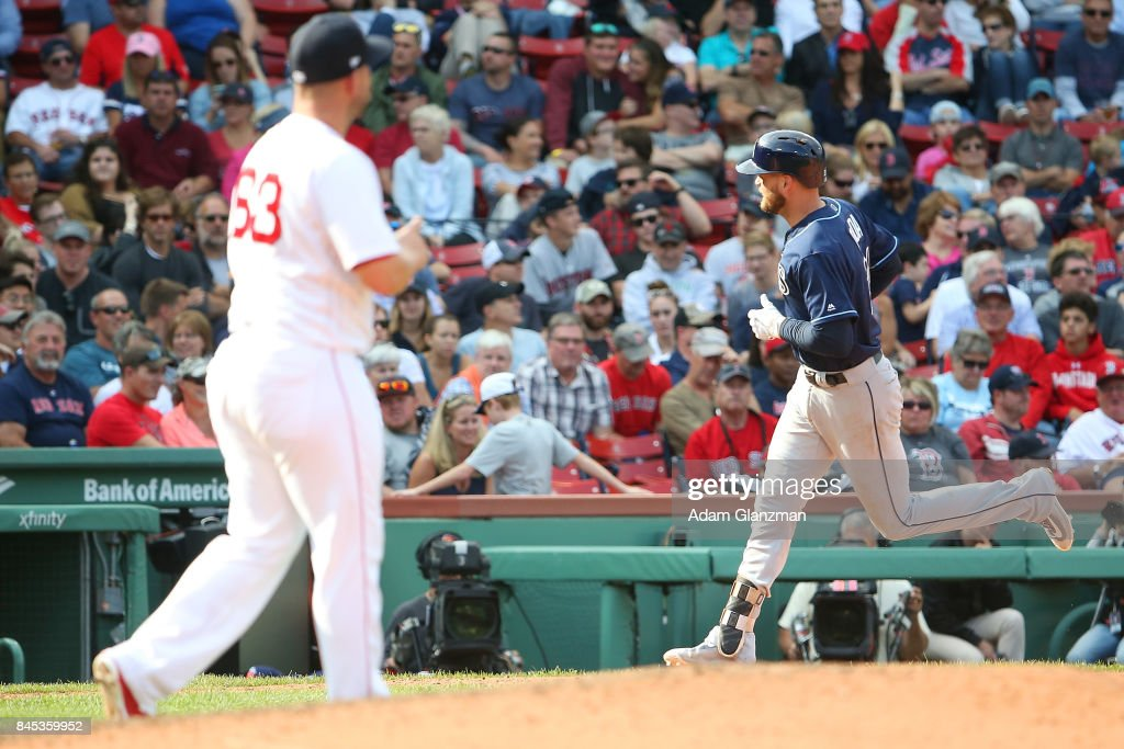 Robby Scott #63 of the Boston Red Sox looks on as Lucas Duda #21 of the Tampa Bay Rays rounds the bases after hitting a solo home run in the seventh inning of a game at Fenway Park on September 10, 2017 in Boston, Massachusetts.