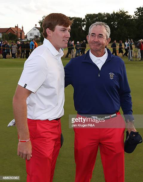 Robby Shelton of the United States is consoled by United States Team Captain John Miller following the Sunday Singles on Day Two of the 2015 Walker...