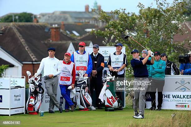 Robby Shelton of the United States plays his tee shot on the 8th hole in his match with Bryson DeChambeau against Gavin Moynihan and Jack Hume of the...