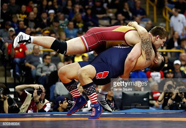 Robby Smith throws Adam Coon during their 130kg Greco-Roman championship match on day 2 of the 2016 U.S. Olympic Team Wrestling Trials at...