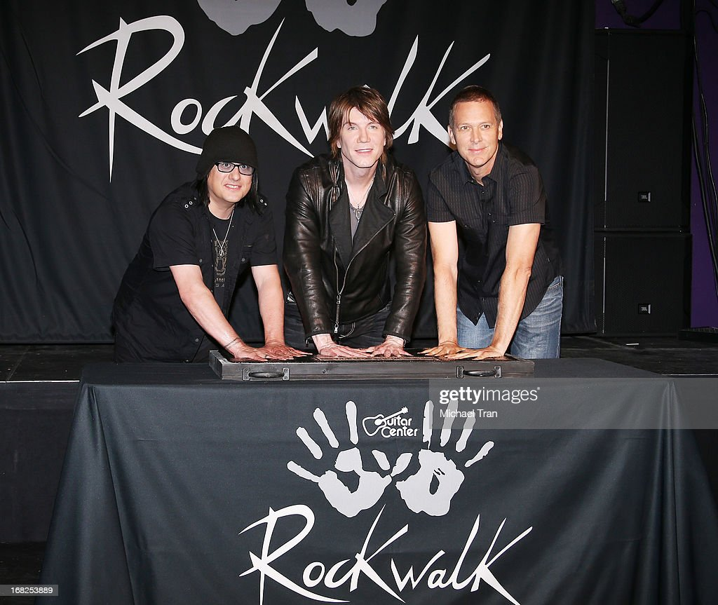 Robby Takac, John Rzeznik and Mike Malinin of the Goo Goo Dolls inducted into Guitar Center's historic RockWalk held at Guitar Center on May 7, 2013 in Hollywood, California.