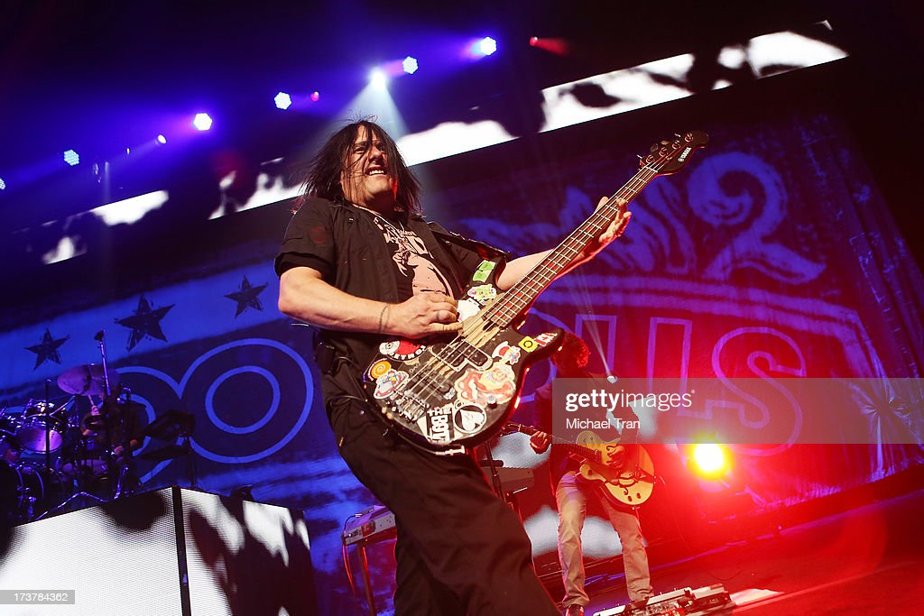 Robby Takac of the Goo Goo Dolls performs onstage at Gibson Amphitheatre on July 17, 2013 in Universal City, California.